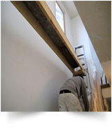 3.  This is the priming and wall repair step followed by painting.  We mark the wall where repairs are needed.
